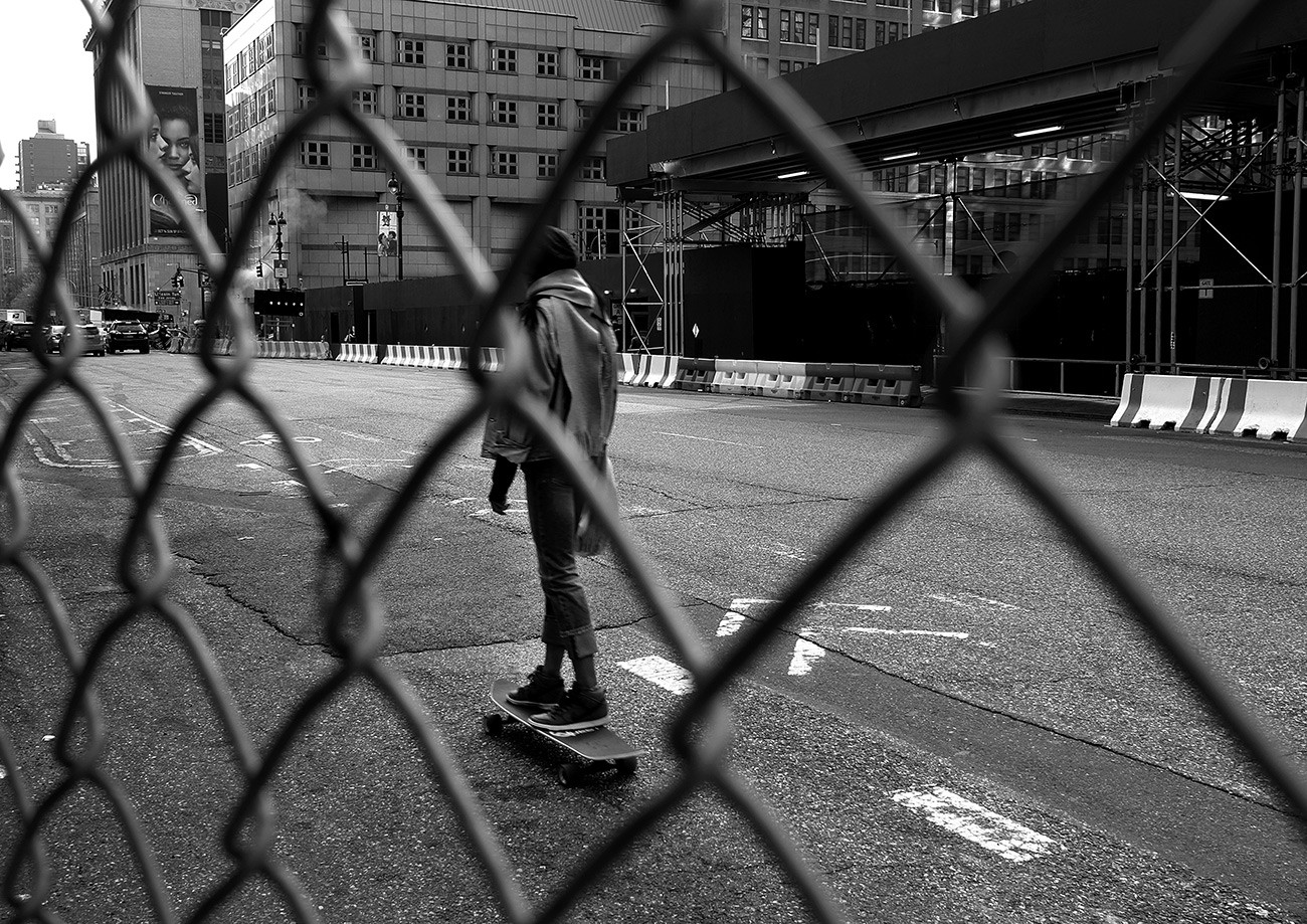 A girl rides a skateboard