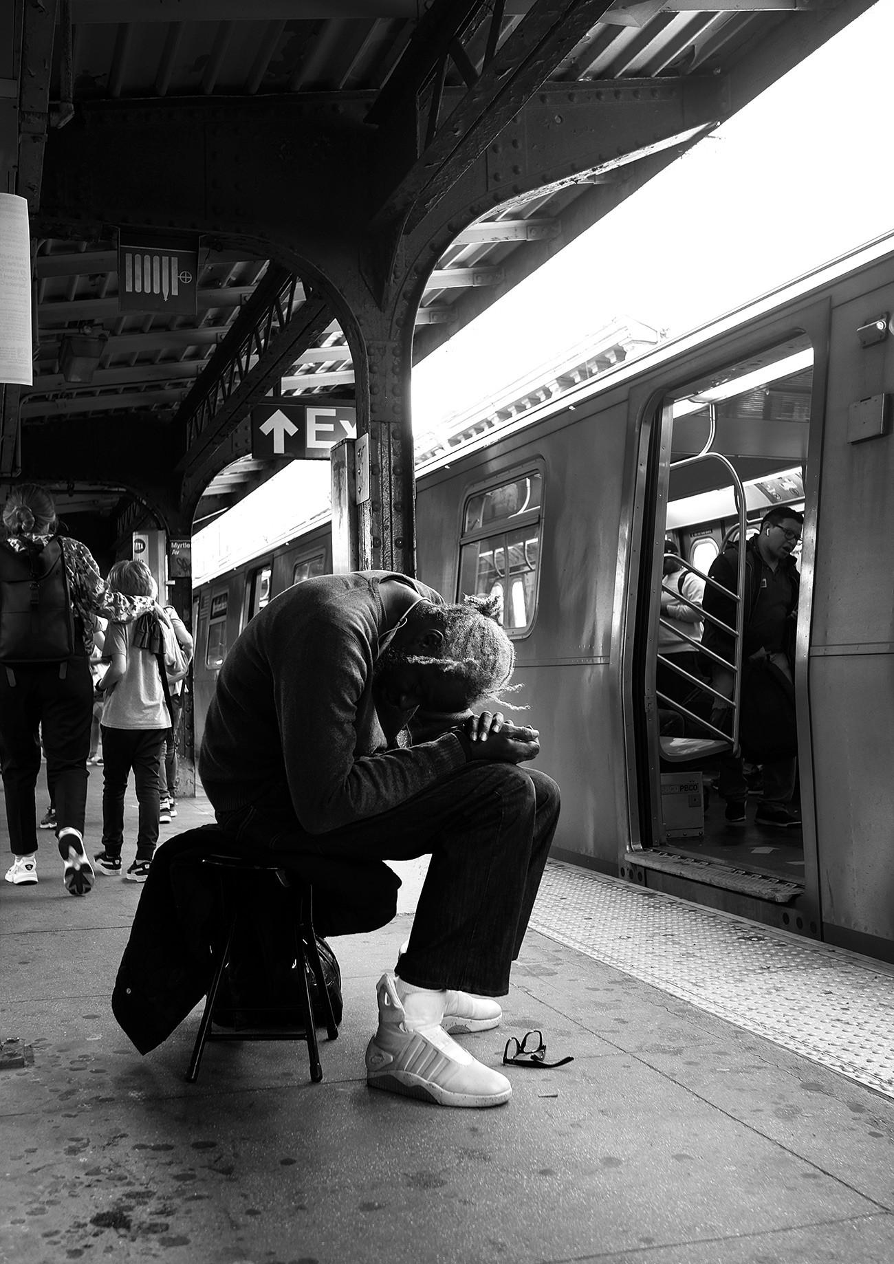 A man sleeping on a platform
