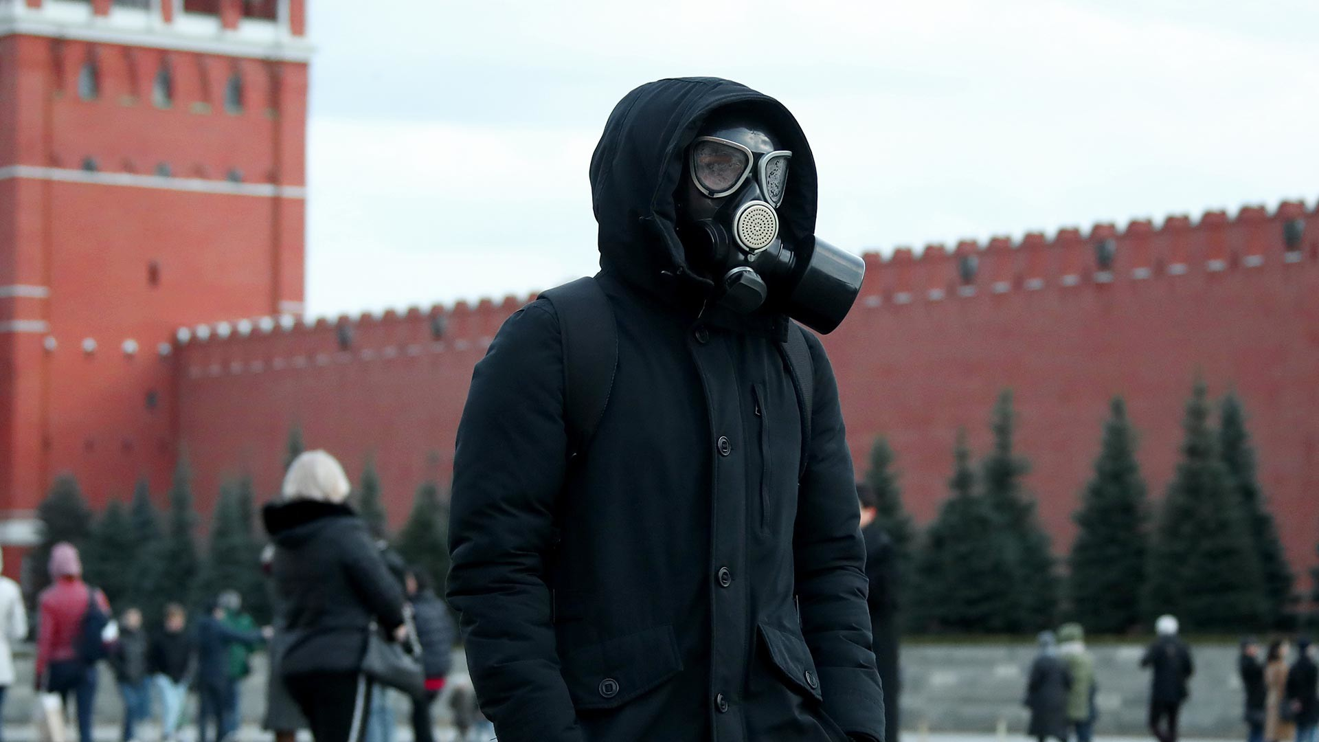 A man in a gas mask walks on Red Square