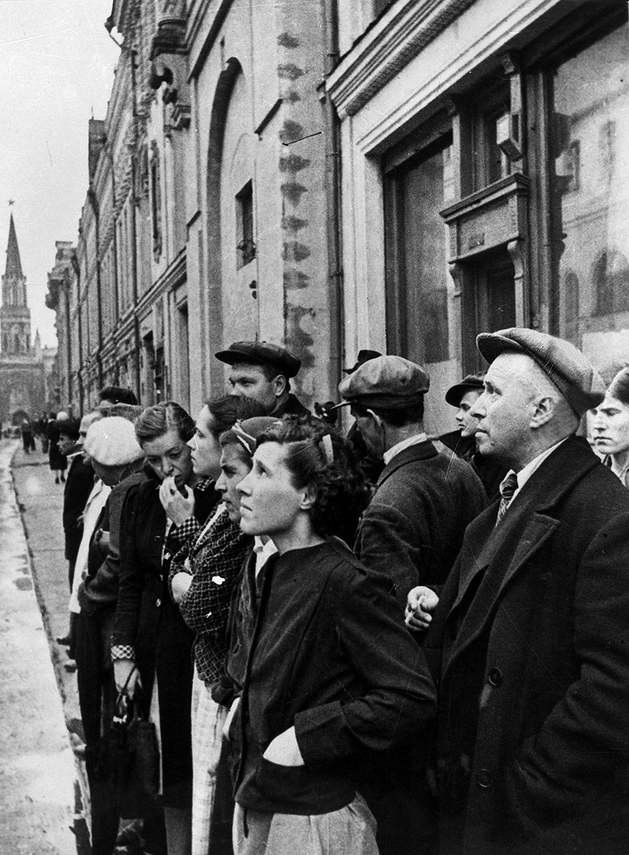 Moscow residents listen to the June 22 government radio announcement on the treacherous invasion of Nazi Germany.