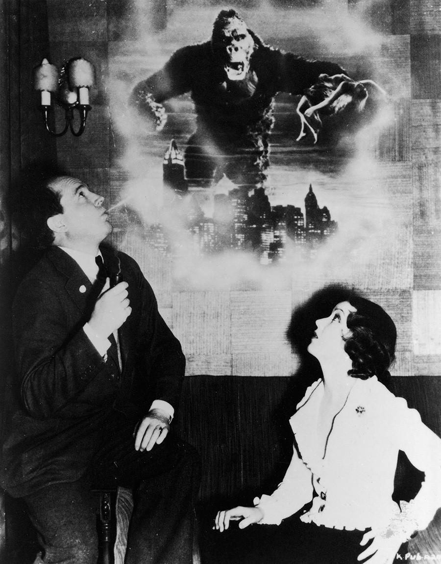 Publicity photograph shows Canadian actress Fay Wray as she listens to American movie director Merian Cooper who tells her the story of 'King Kong.'