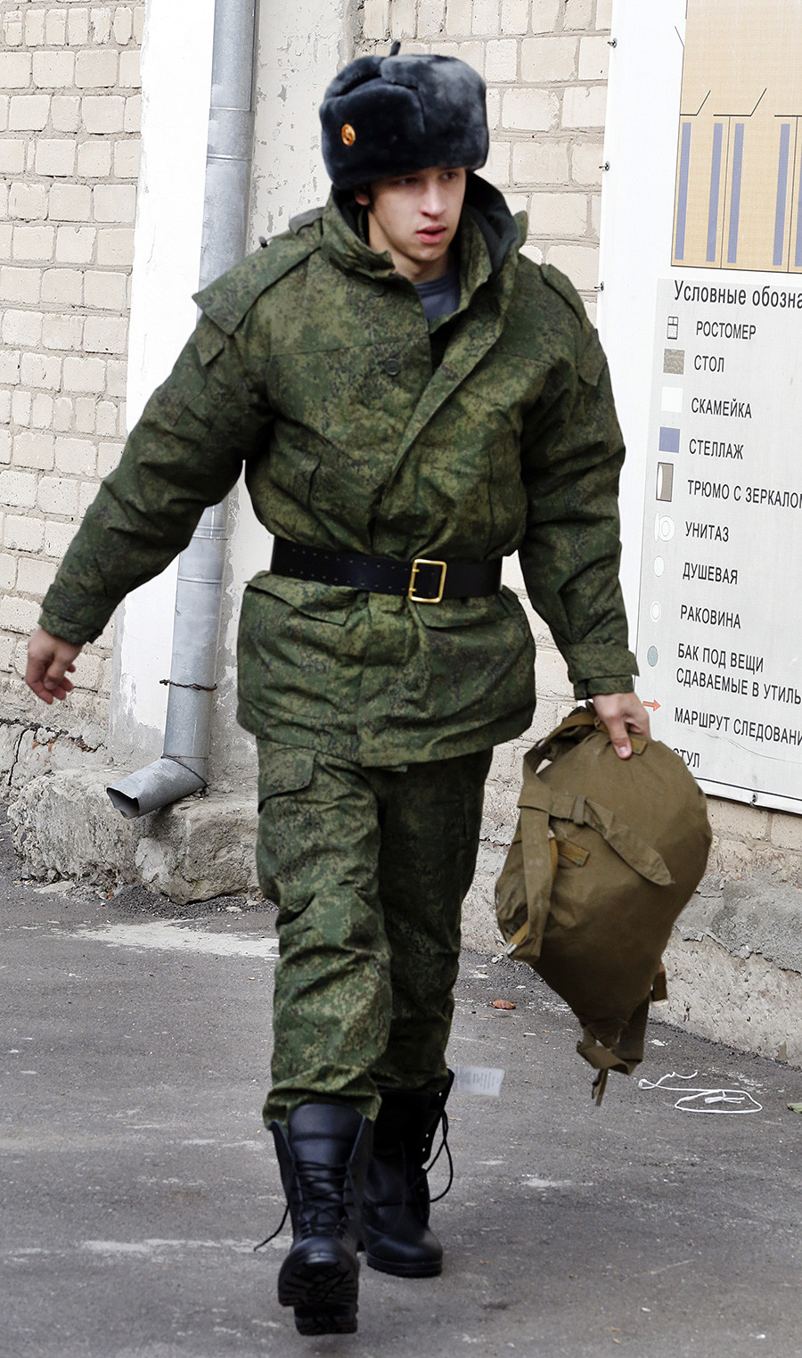 A conscript in military uniform at a recruiting station in the town of Bataisk.