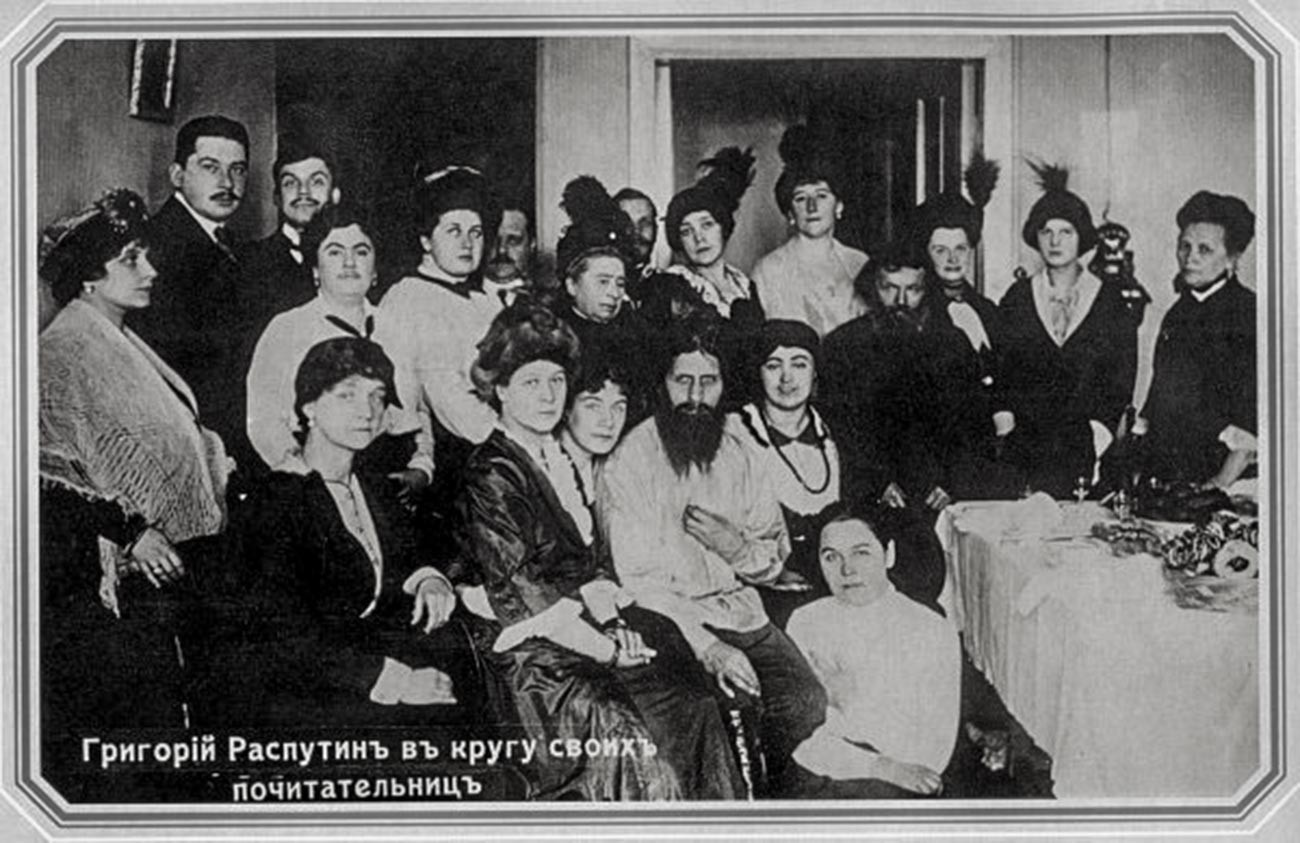 Rasputin and his admirers, 1914. His telephone can be seen on the right. This image has been widely reproduced in the press and various books since 1917.