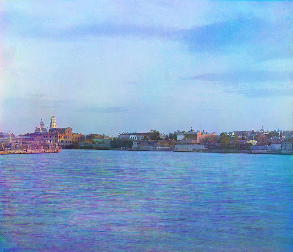 View of Chelyabinsk down the Miass River. Visible on far side are brick commercial buildings with Cathedral of Nativity of Christ (left) and Convent of the Hodegetria Icon of the Virgin (far right) - both demolished in the Soviet period. Late summer 1909.