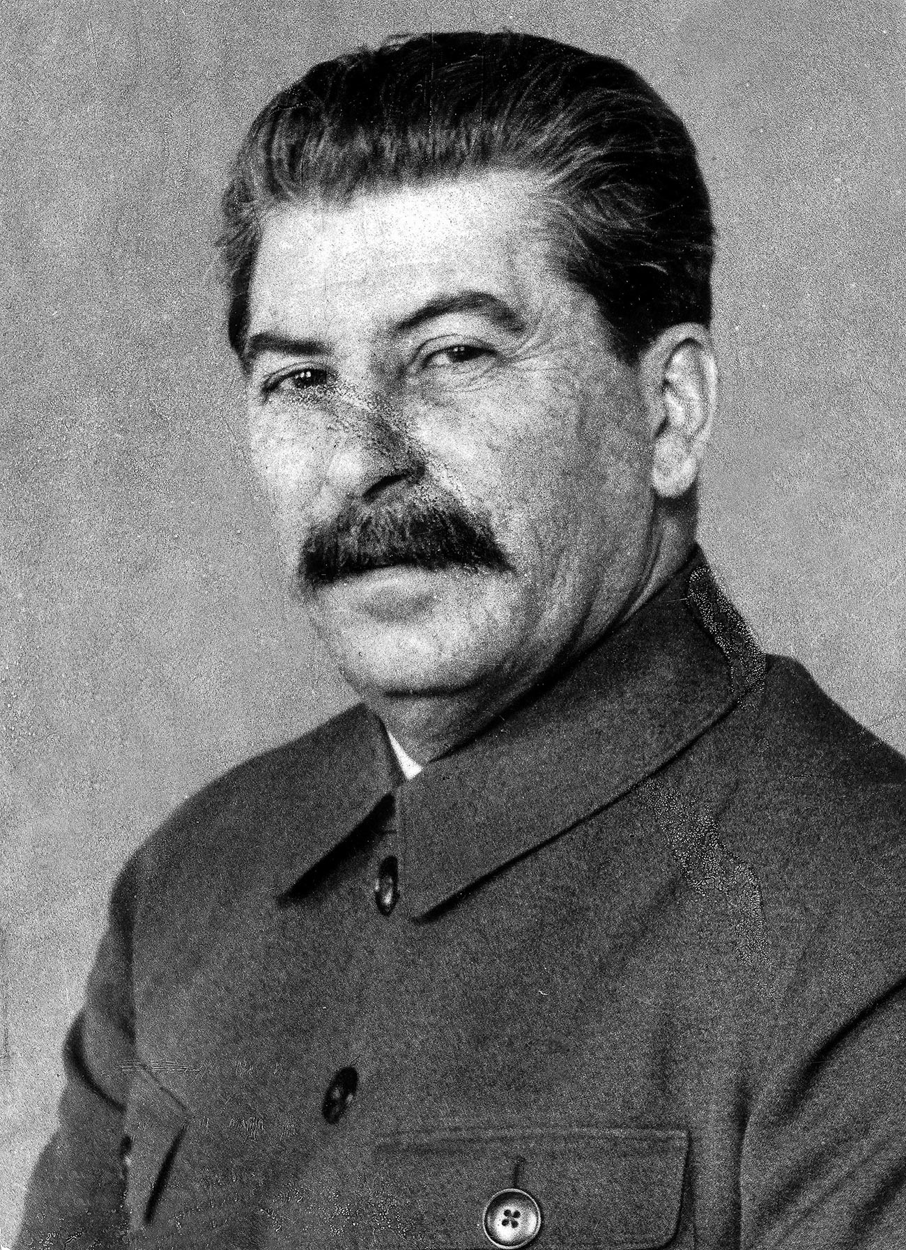 This is one of the rare photos of Stalin where pockmarking is obvious on his face.