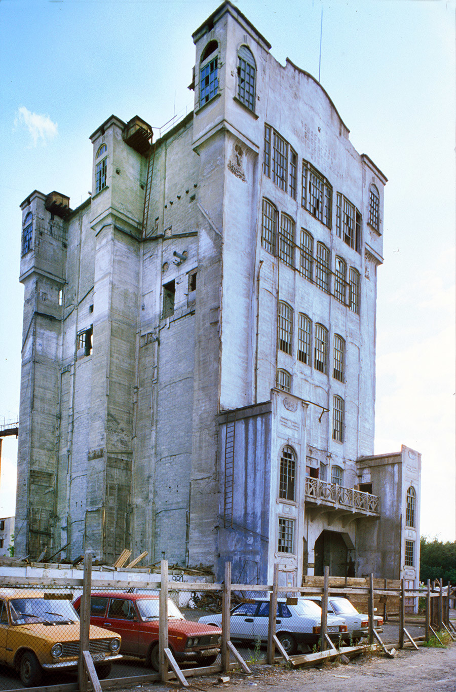 State Bank Grain Elevator. Built in 1914-16 with advanced reinforced concrete technology as part of a national program for grain storage centers. Used until 1990s, then partially demolished. July 12, 2003.