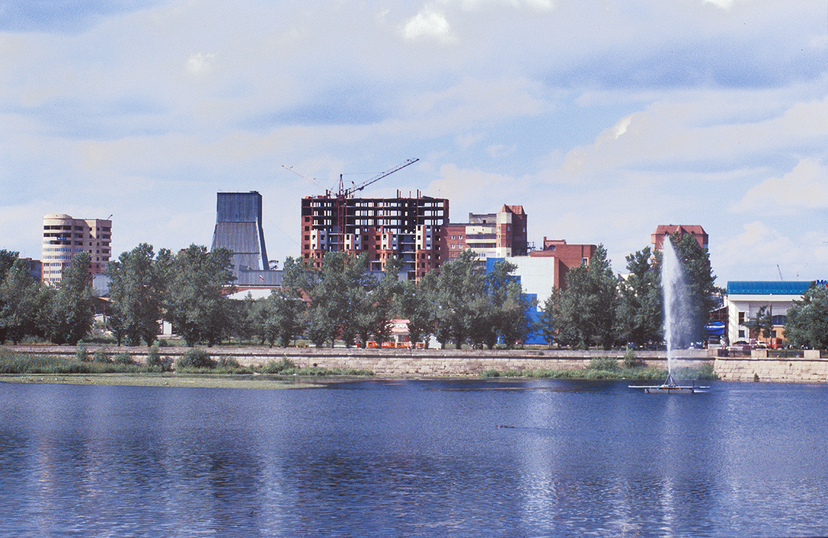View across Miass River toward Kirov (formerly Ufa) Street. July 13, 2003.