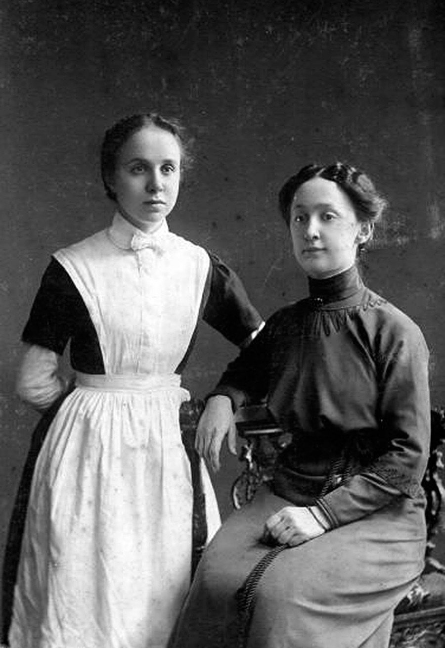 A portrait of a young woman and a girl