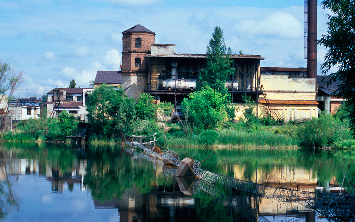 View of factory pond, Kyshtym factory & water tower near former Demidov estate. July 14, 2003.