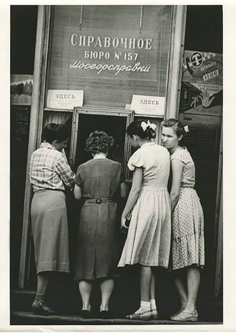 Women forming a line to an information desk