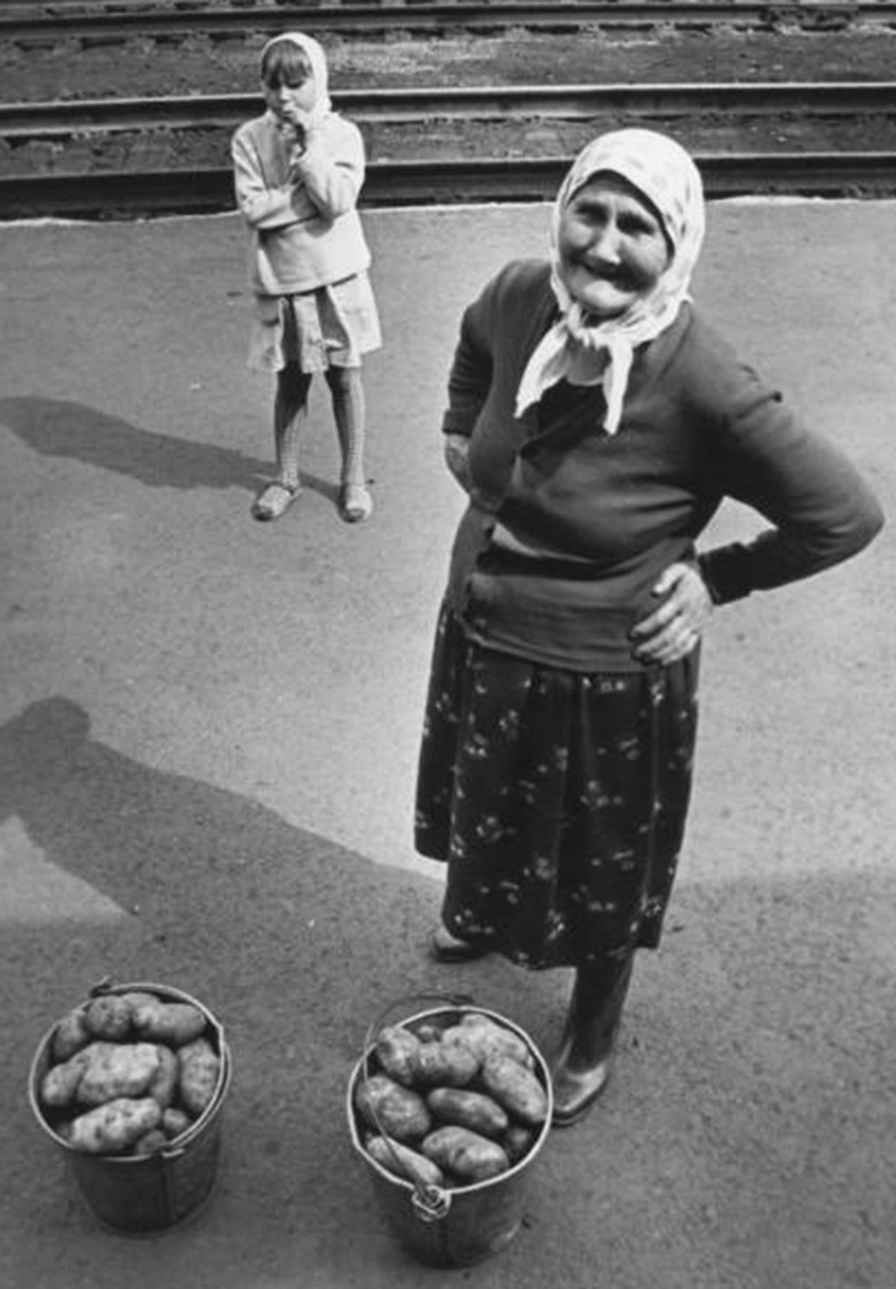 An old woman selling potatoes at a railway station somewhere in the Urals, 1974