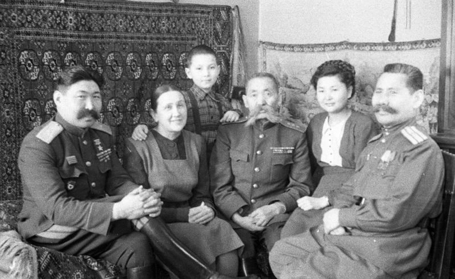 Hero of the Soviet Union, horse troop general Oka Gorodovikov, center, with his family, 1940s