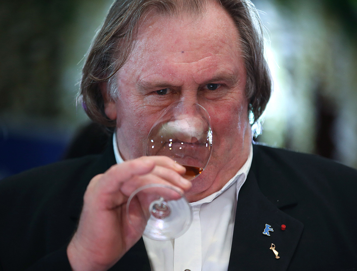 French actor Gerard Depardieu samples wine at a dinner at the Lastochka Restaurant.