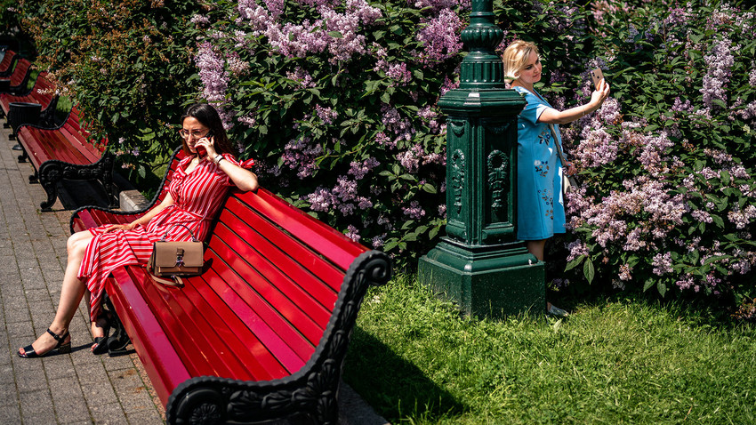 Women enjoy a warm and sunny day in a park in downtown Moscow on June 9, 2020, on the first day after Moscow lifted a range of anti-coronavirus measures including a strict lockdown set up to curb the spread of the COVID-19 caused by the novel coronavirus