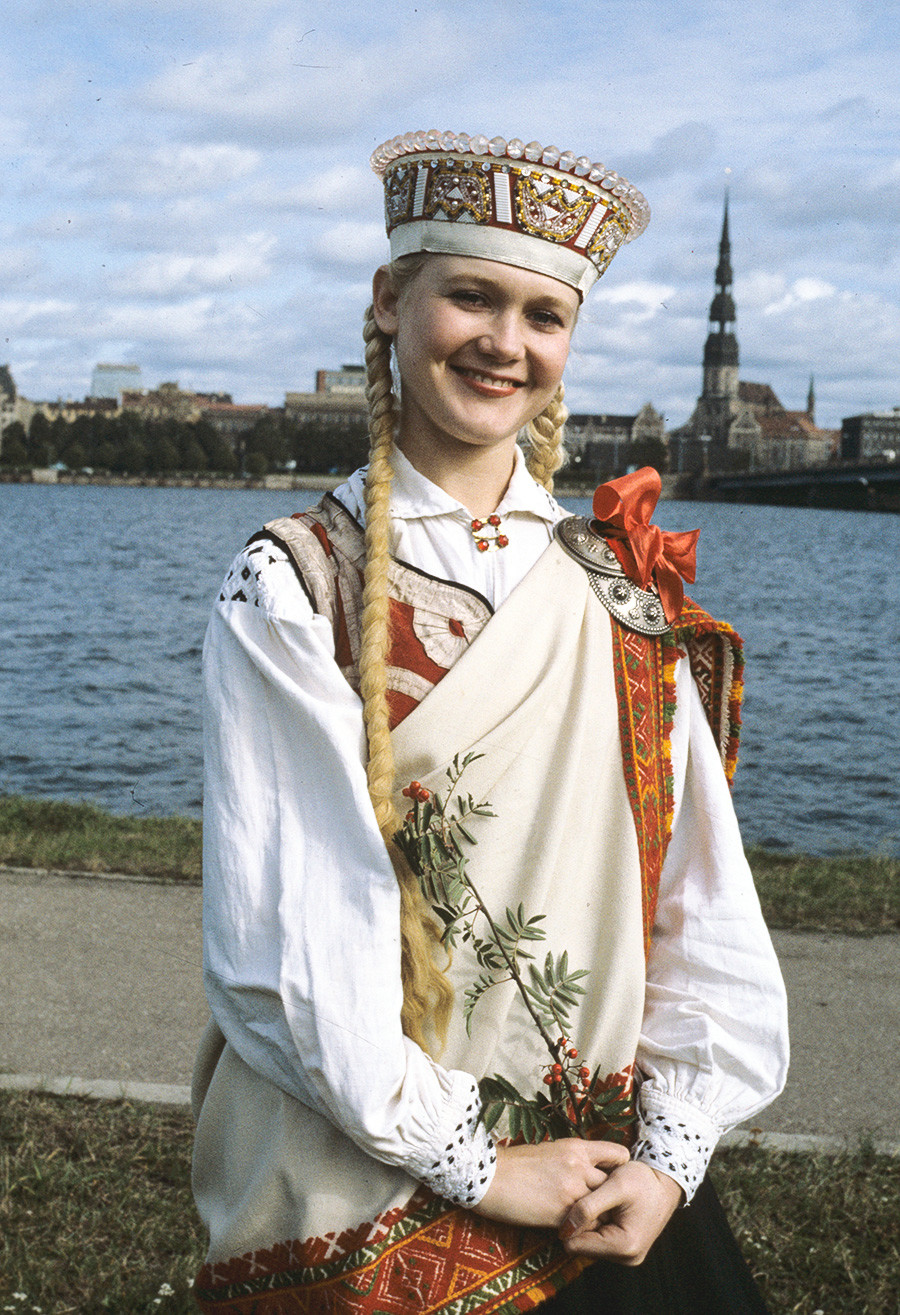 A girl in a Latvian national costume on the Riga waterfront, 1983.