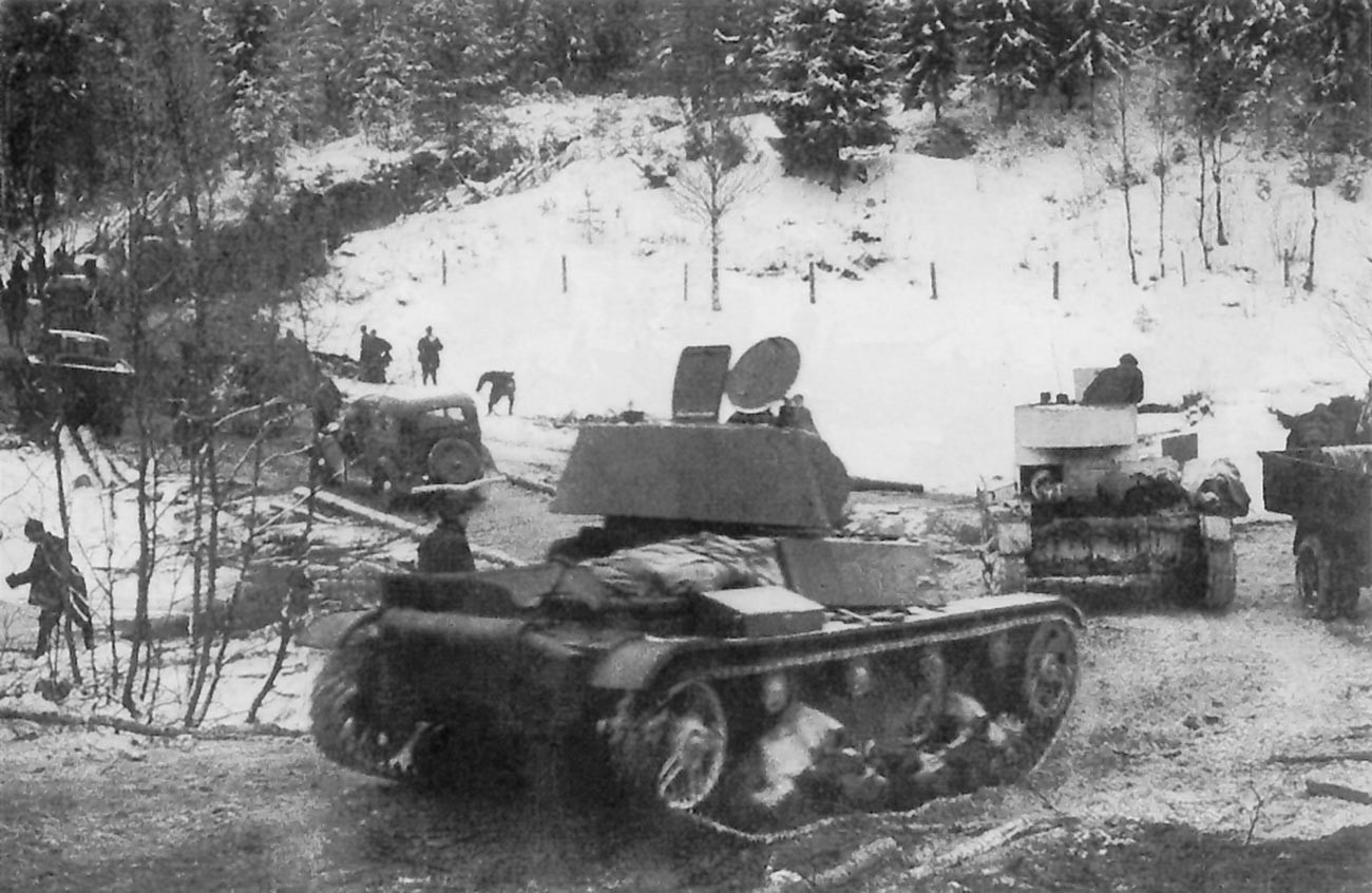 Soviet T-26 light tanks and GAZ-A trucks of the Soviet 7th Army during its advance on the Karelian Isthmus, December 2, 1939.