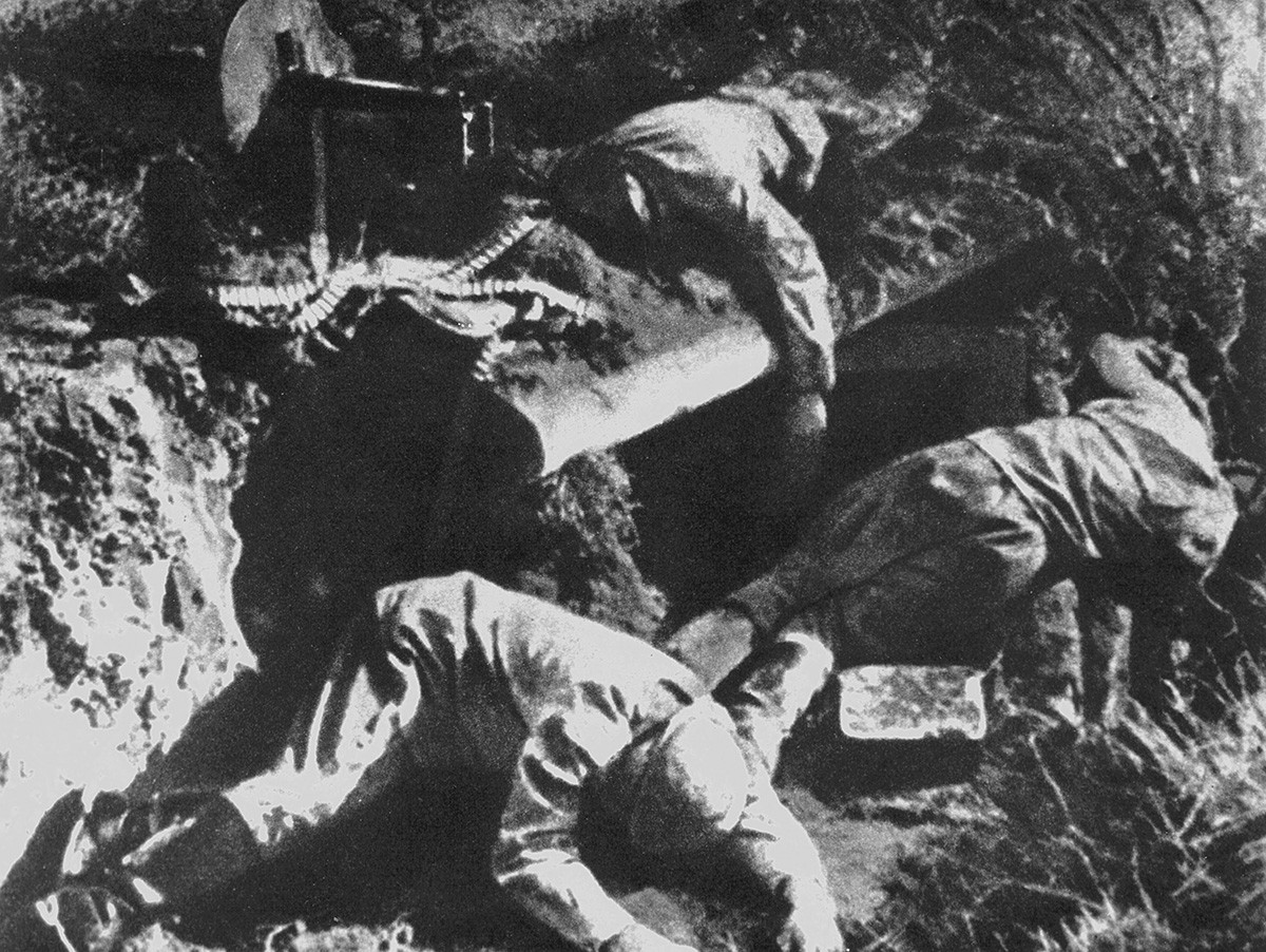 Corpses of Soviet soldiers lying next to their machine gun, in the ruins of  Brest Fortress.