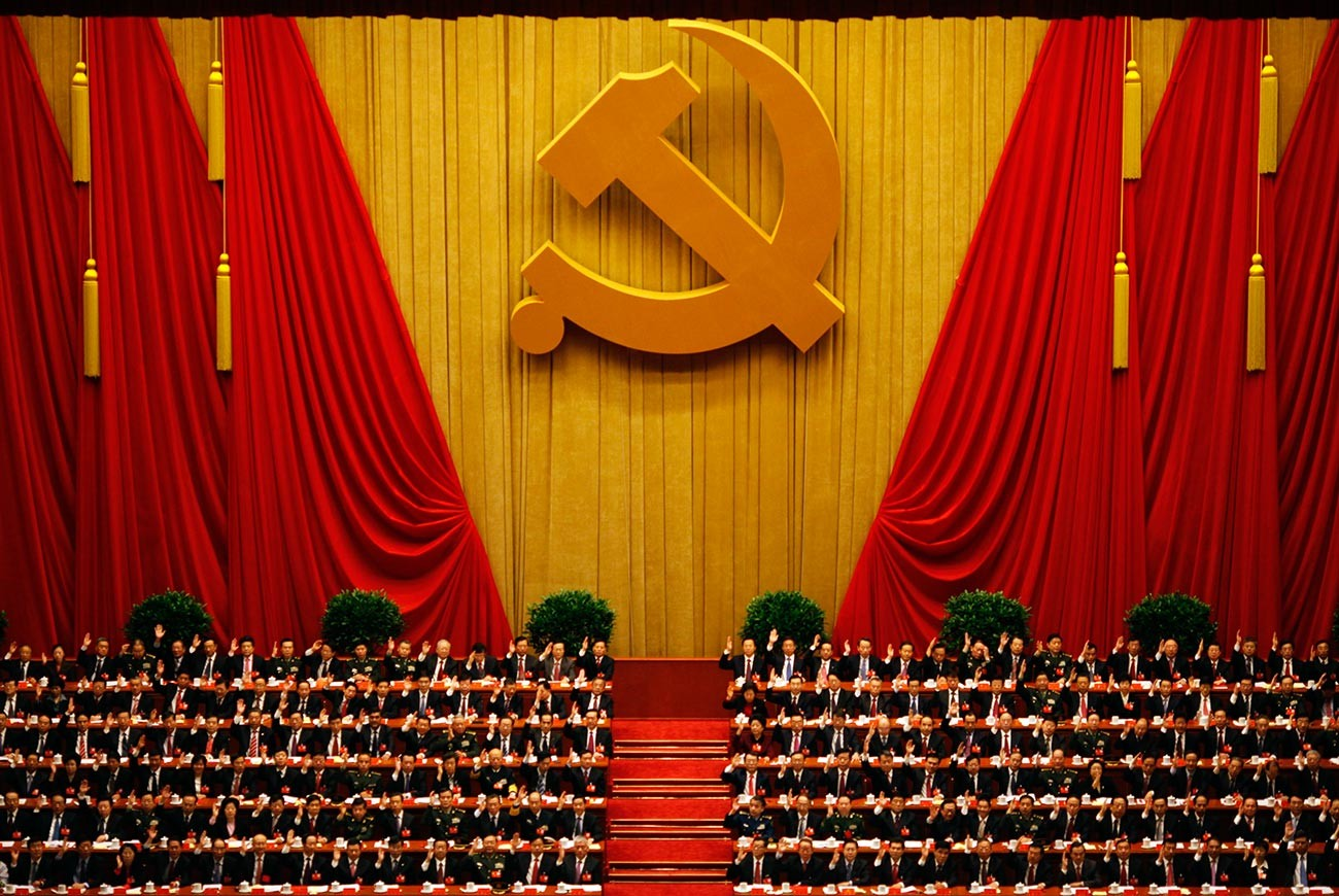 A general view shows delegates raising their hands as they take a vote at the closing session of the 18th National Congress of the Communist Party of China at the Great Hall of the People in Beijing.