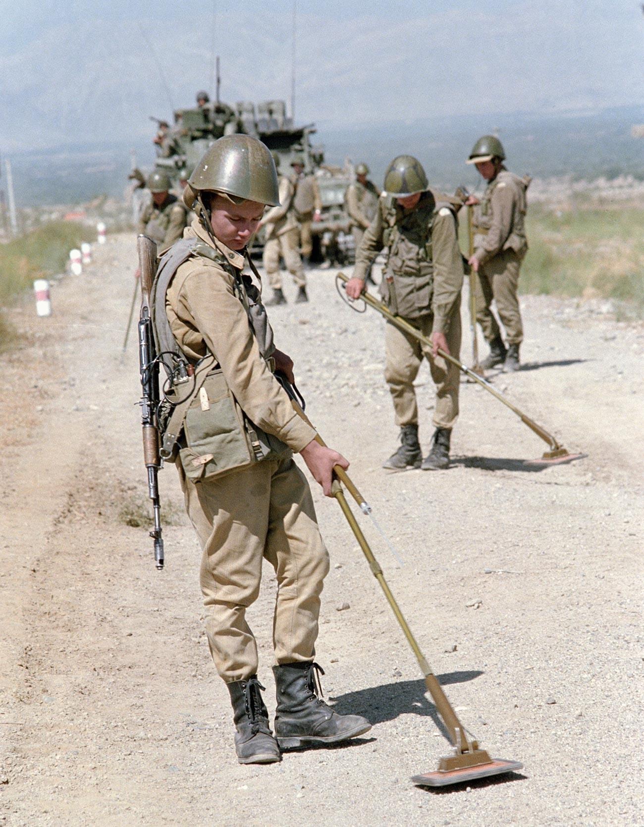 Soviet troops demine a road in Afghanistan.