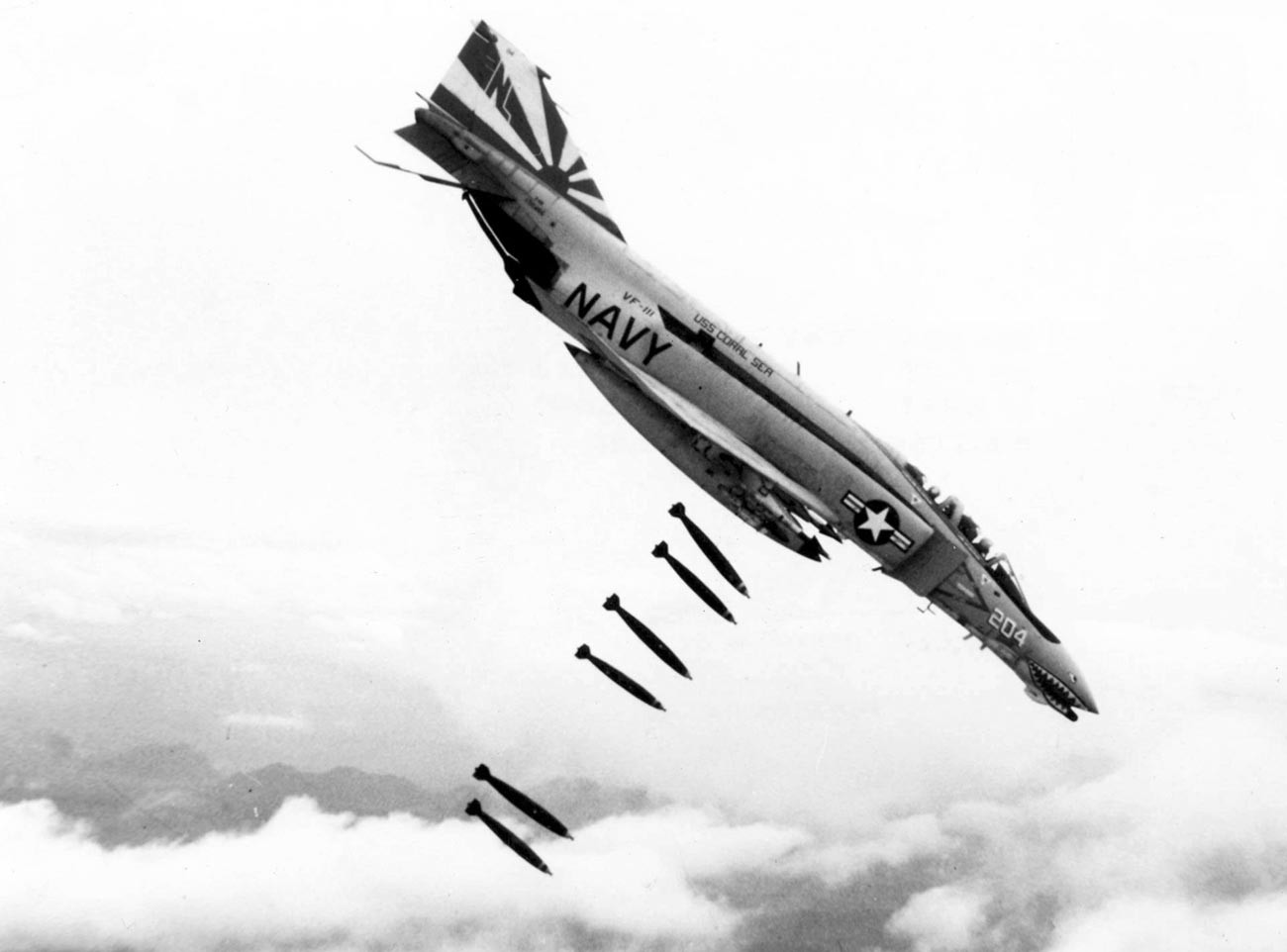 An F-4B Phantom II of Fighter Squadron VF-111 Sundowners drops 227 kg Mk 82 bombs over Vietnam during 1971.