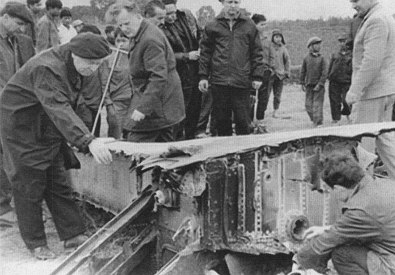 Soviet specialists examine the fragments of the B-52 Stratofortress near Hanoi, 1972.