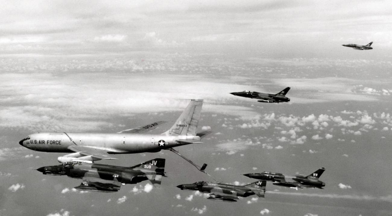 A U.S. Air Force SAM Hunter killer group of the 388th Tactical Fighter Wing takes fuel on the way to North Vietnam for a strike during
