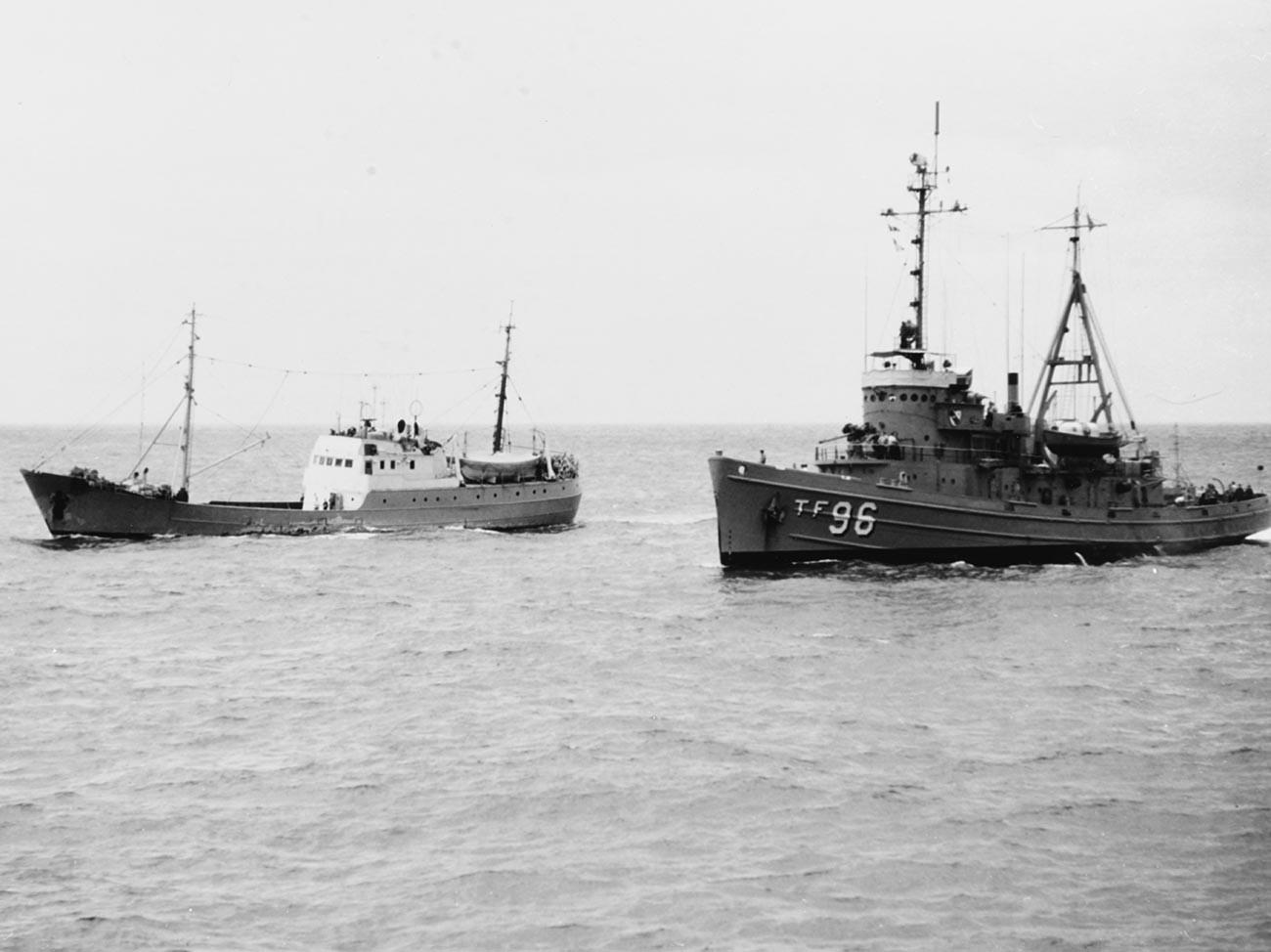 USS Abnaki (ATF-96) and Soviet trawler Gidrofon underway in the South China Sea, 1967.