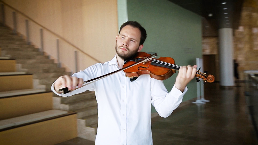 Michael Schaffarczyk plays violin at the Mariinsky Theater Symphony Orchestra