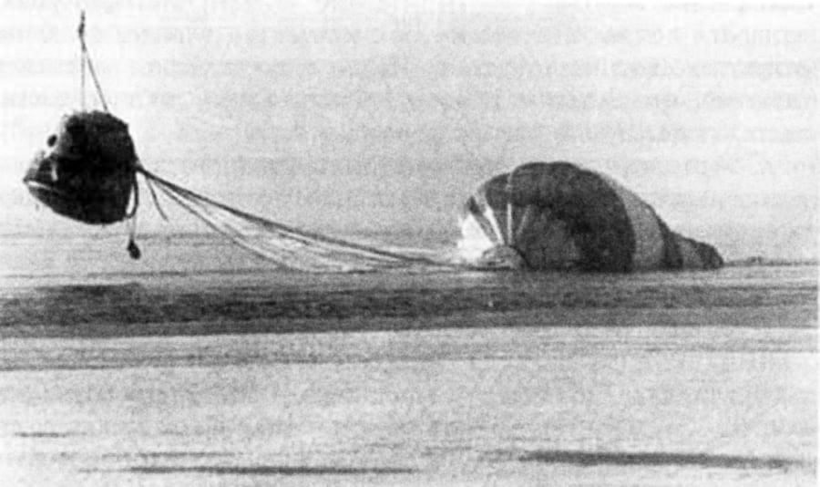 Towing the device with a parachute by helicopter