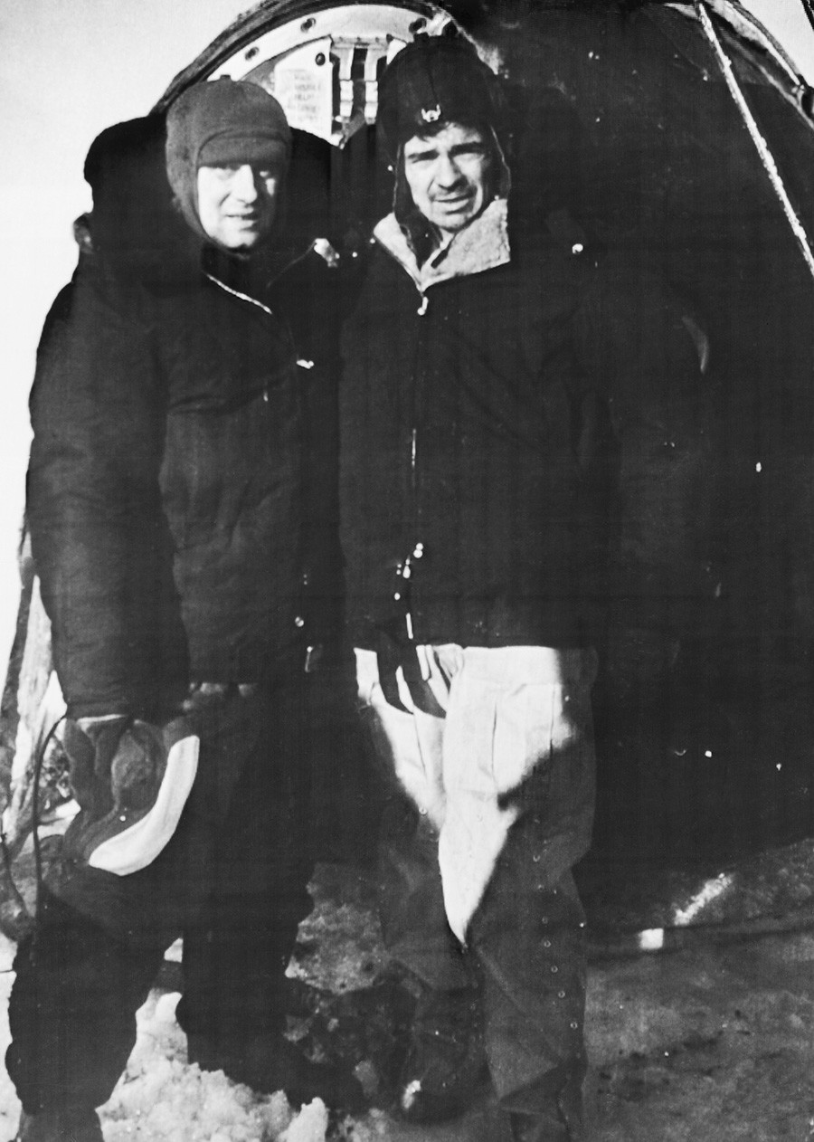 The crew members of the Soyuz-23 spacecraft, commander Vyacheslav Zudov and flight engineer Valery Rozhdestvensky pose for a photo after the landing on the surface of the Tengiz Lake