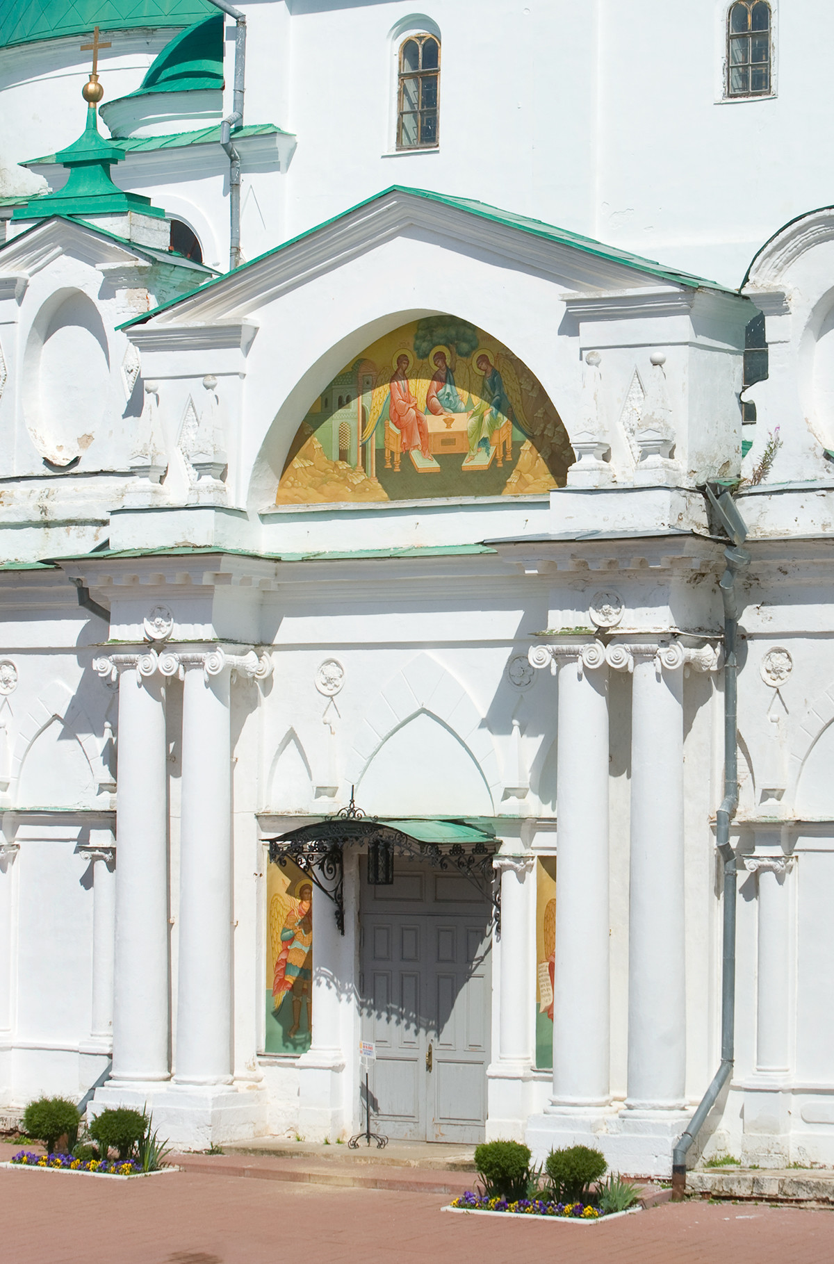 Cathedral of Conception of St. Anne. West view with main entrance. Painting of Old Testament Trinity on tympanum of narthex pediment. July 7, 2019