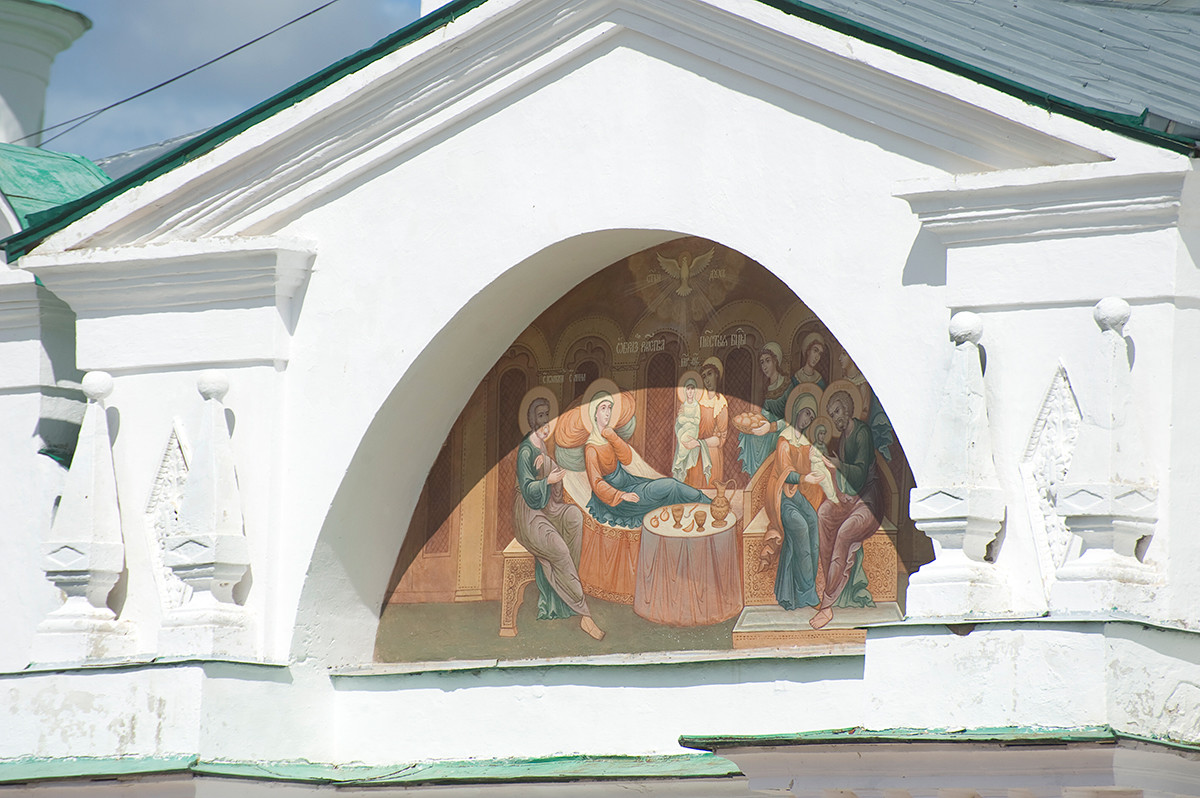 Church of St. Yakov. Restored painting of Nativity of the Virgin on tympanum of narthex pediment. July 7, 2019