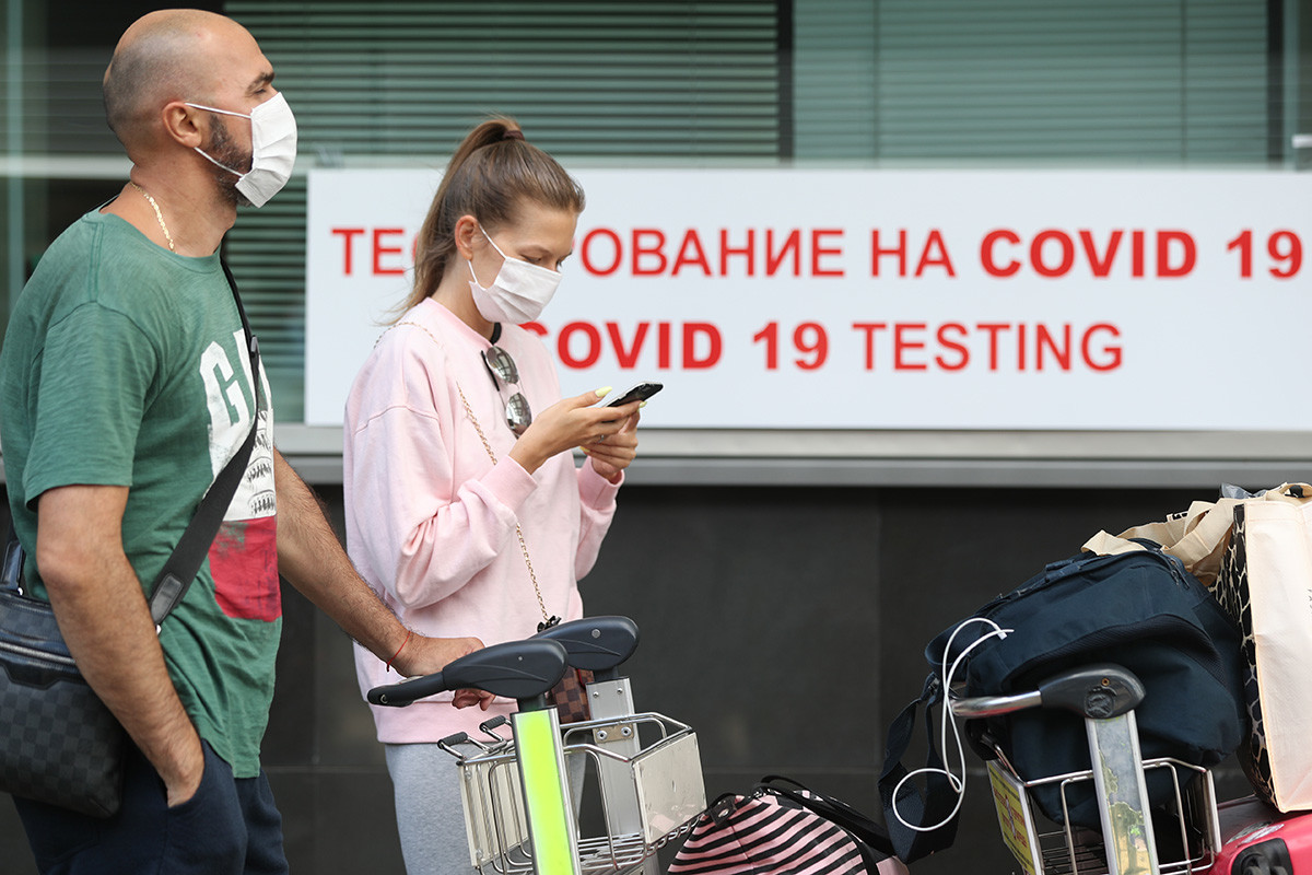 Passengers queue for rapid COVID-19 testing launched at Vnukovo International Airport with the use of testing kits developed by the Russian-Japanese joint venture Evotech-Mirai Genomics. The results are issued in 60min in Russian and English, August 7,2020