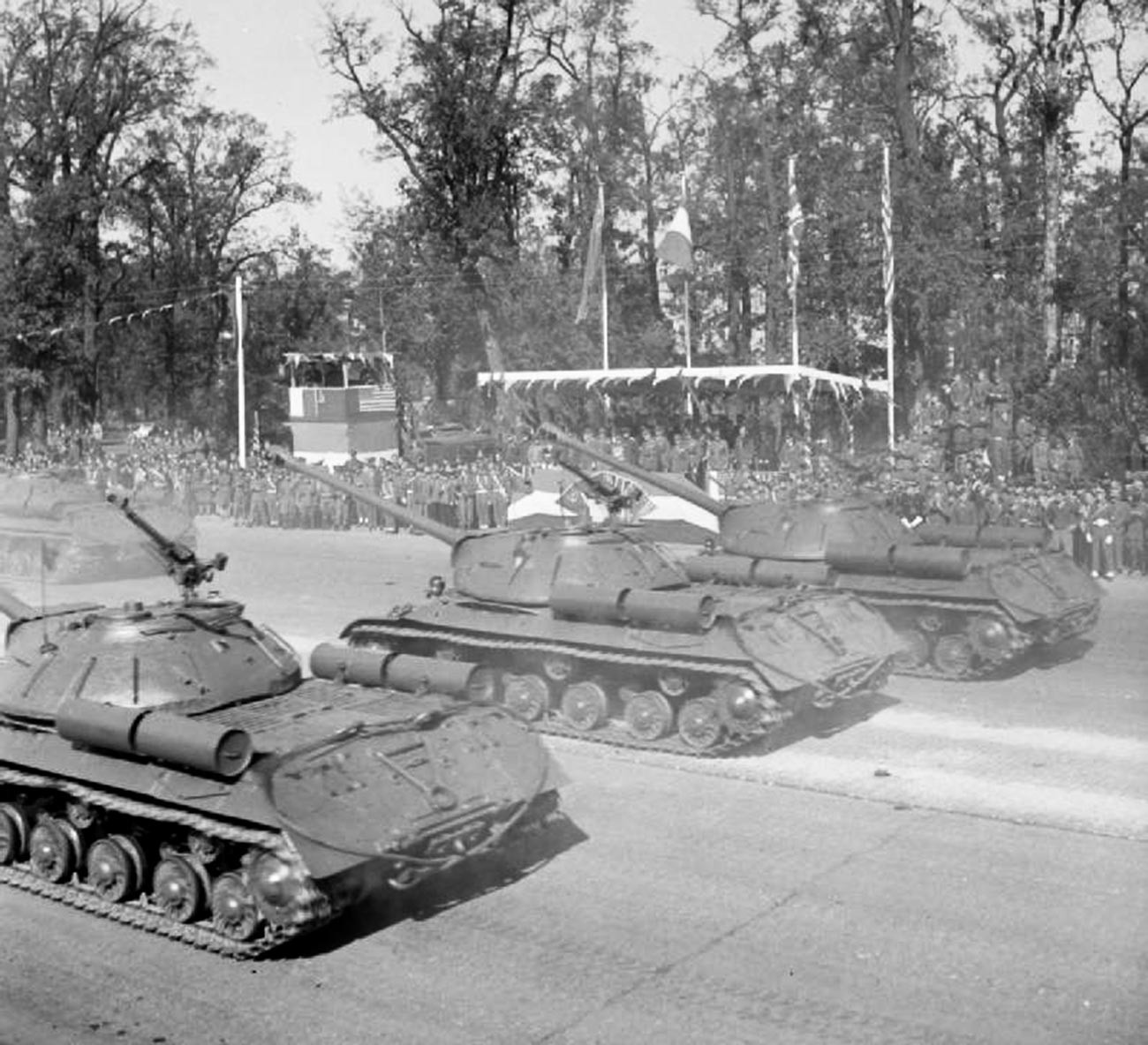 Soviet IS-3 tanks driving down the Charlottenburger Chaussee in Berlin during the parade.