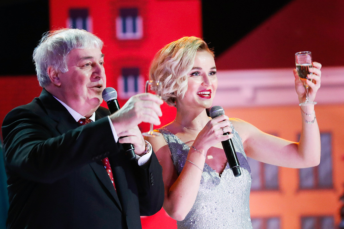 Mikhail Gutseriev and singer Polina Gagarina at the
