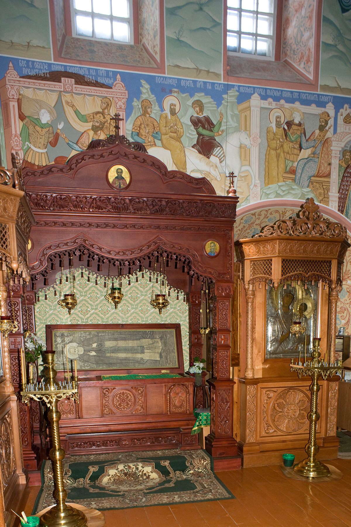 St. Avraamy Epiphany Monastery. Church of St. Nicholas over Holy Gate, Interior, north wall with sarcophagus containing relics of St. Avraamy of Rostov. July 6, 2019