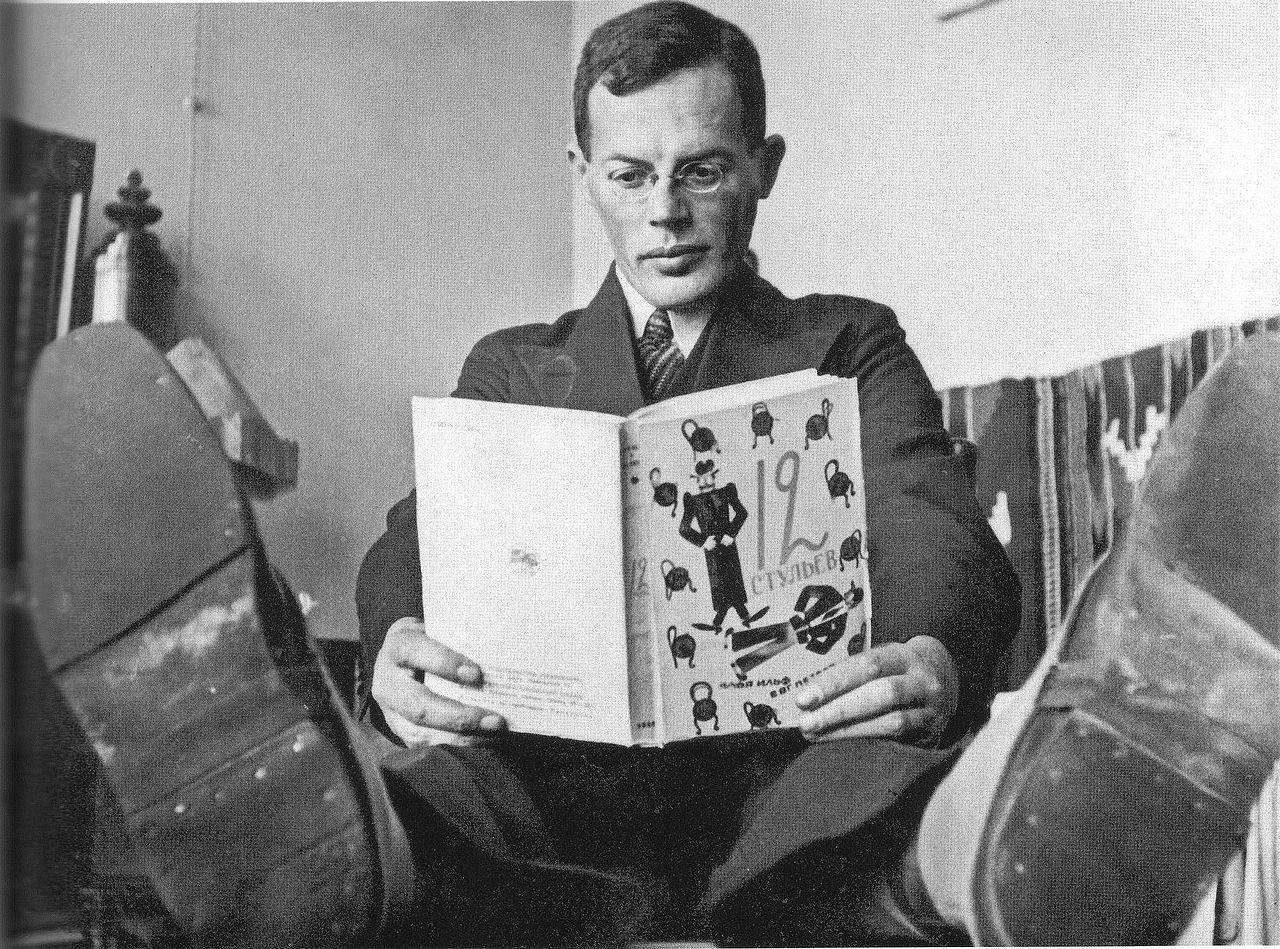 Ilya Ilf posing with The Twelve Chairs