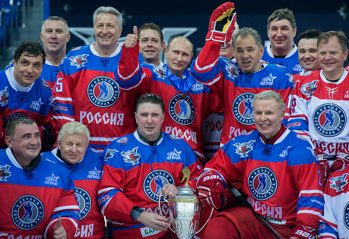 Russian President Vladimir Putin (center in the background) after the match