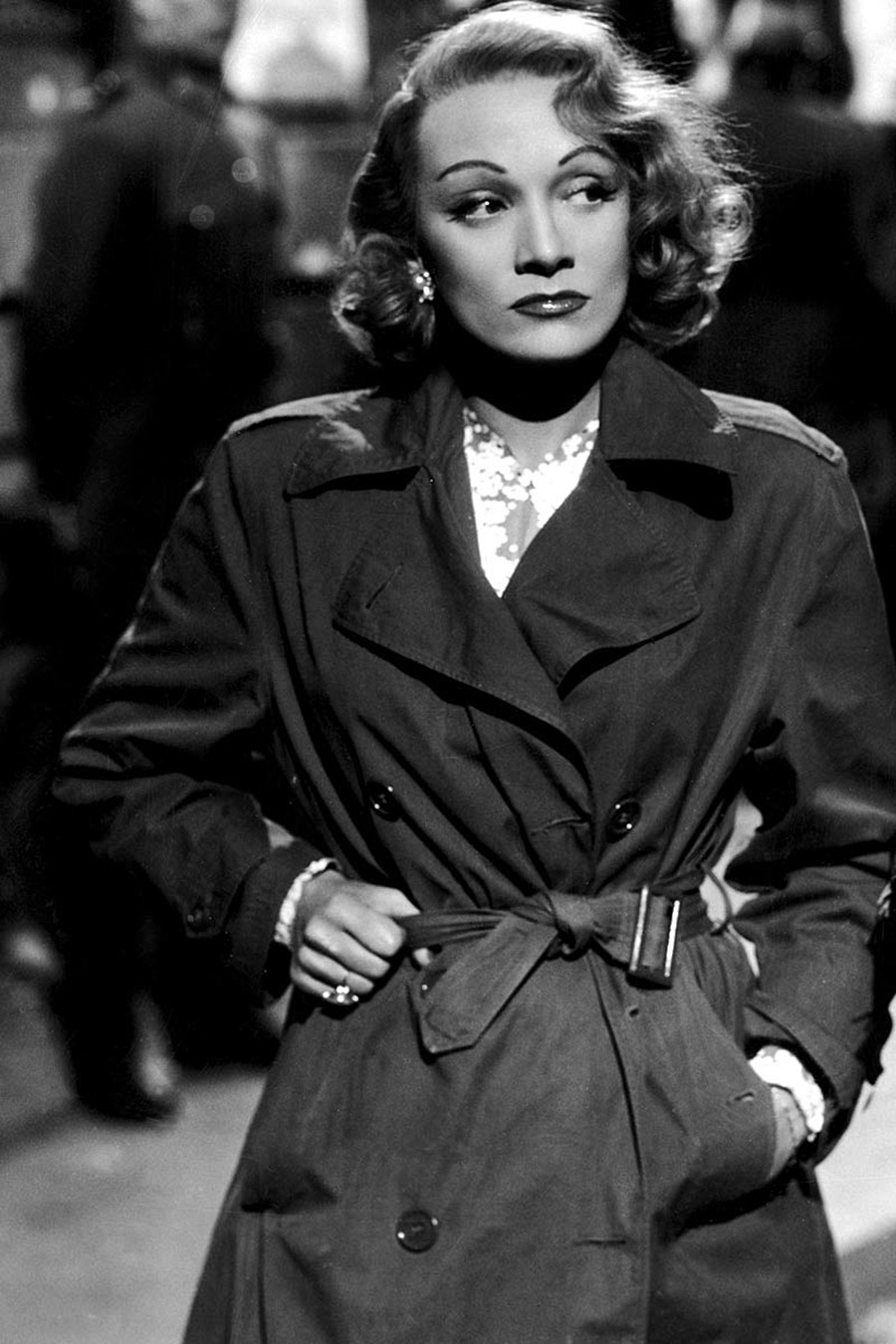 Marlene Dietrich wearing a trench coat in A Foreign Affair.
