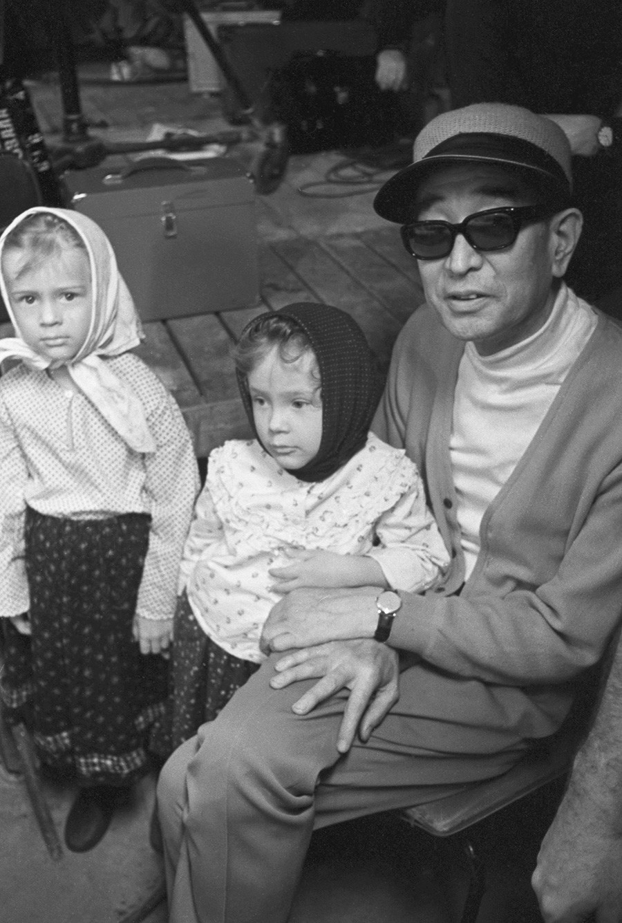 Akira Kurosawa with two Muscovites during 'Dersu Uzala' shooting, 1975