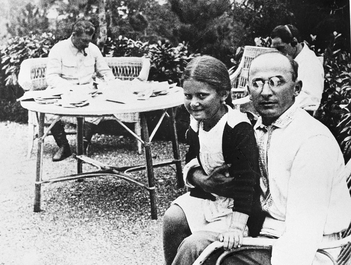 Joseph Stalin and Lavrenty Beria and Stalin's daughter Svetlana on his lap
