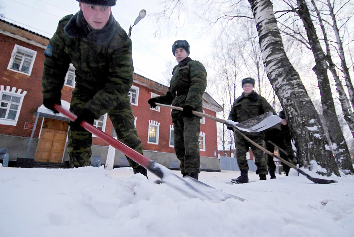 Snow removal on the territory of a military unit located in the village of Novoselitsy, Novgorod region