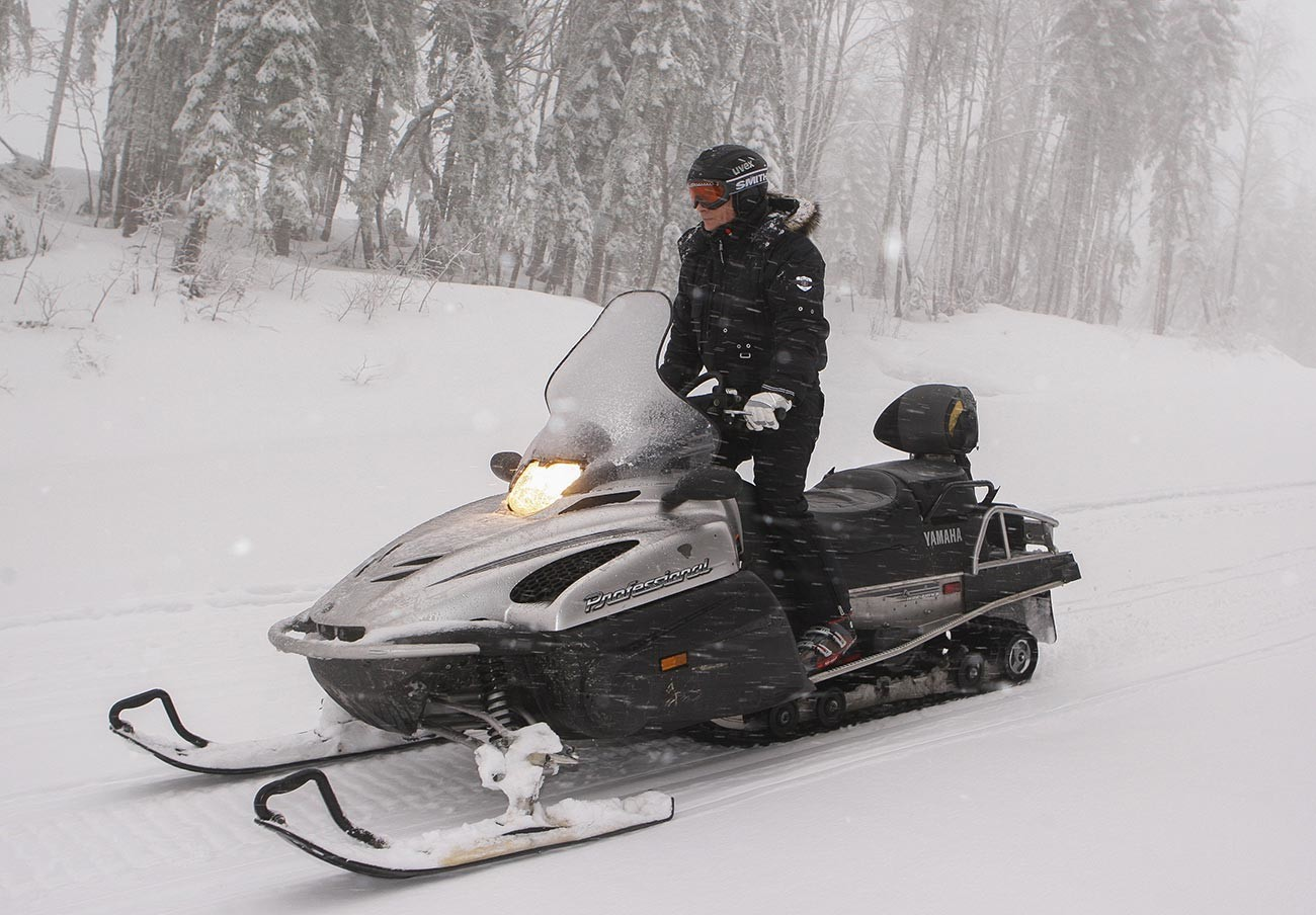 Vladimir Putin drives a snowmobile at Russia's ski resort Krasnaya Polyana near Sochi