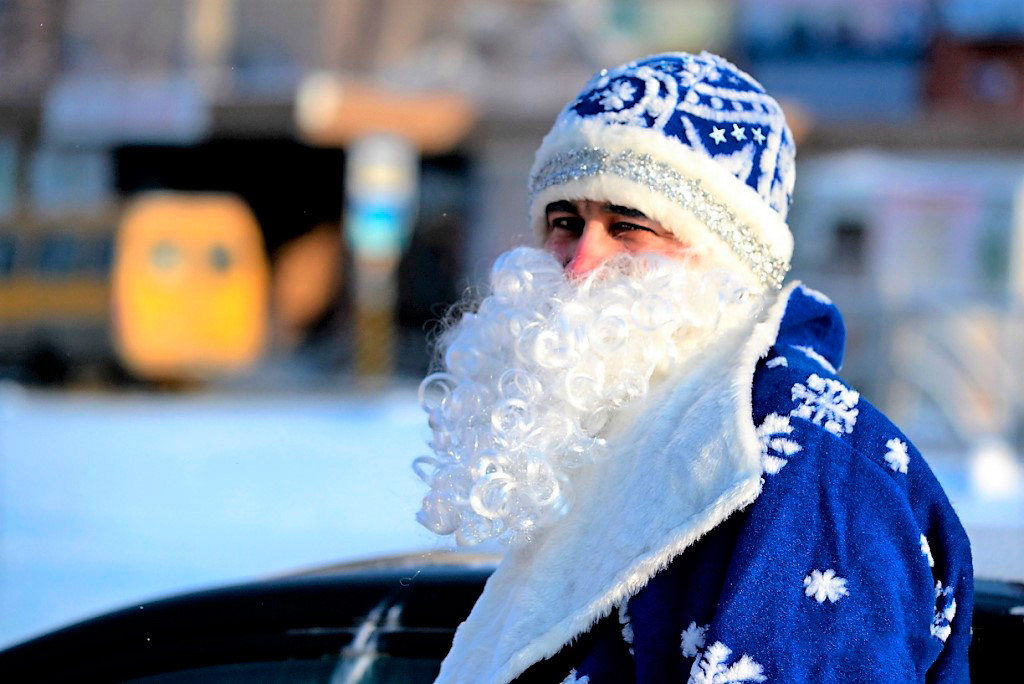 Murod in the costume of Grandfather Frost.