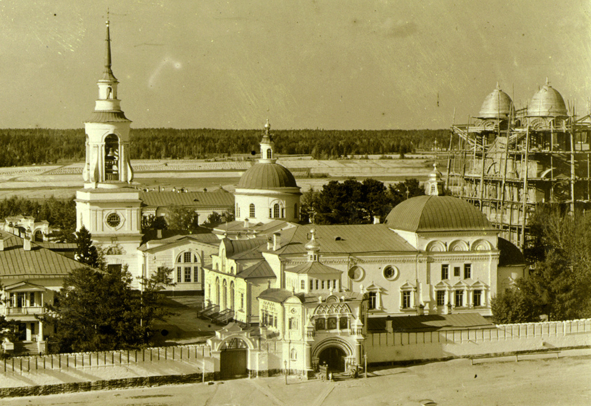 Monastery of St. Nicholas, view northeast from Trinity Cathedral bell tower. From left: bell tower & Transfiguration Church, St. Nicholas Church (demolished), Church of Sts. Simeon & Anna over Holy Gate, Cathedral of Elevation of the Cross (in scaffolding). Summer 1909.