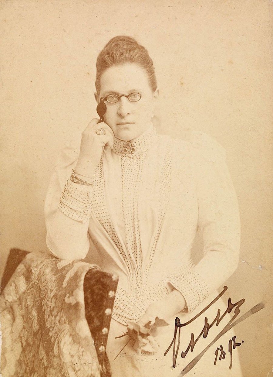Grand Duchess Olga Konstantinovna using a lorgnette
