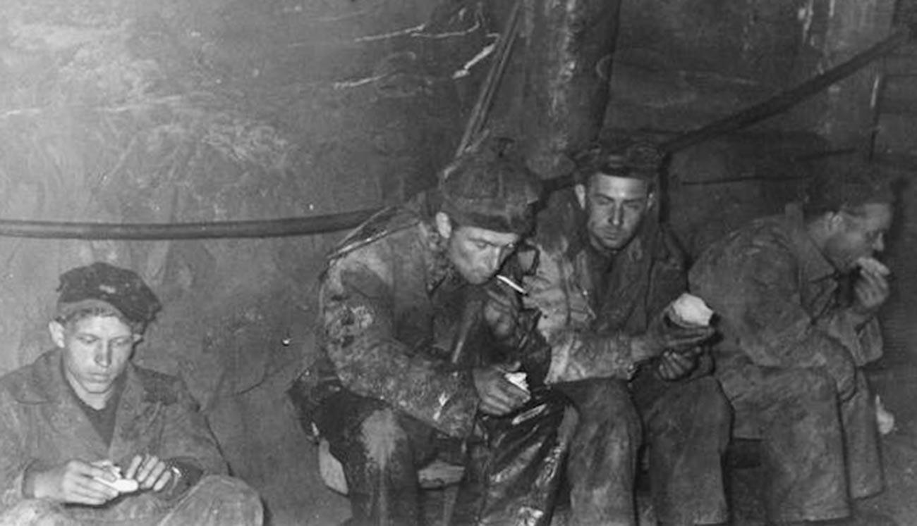 Political prisoners on a break inside a mine in a Far East camp