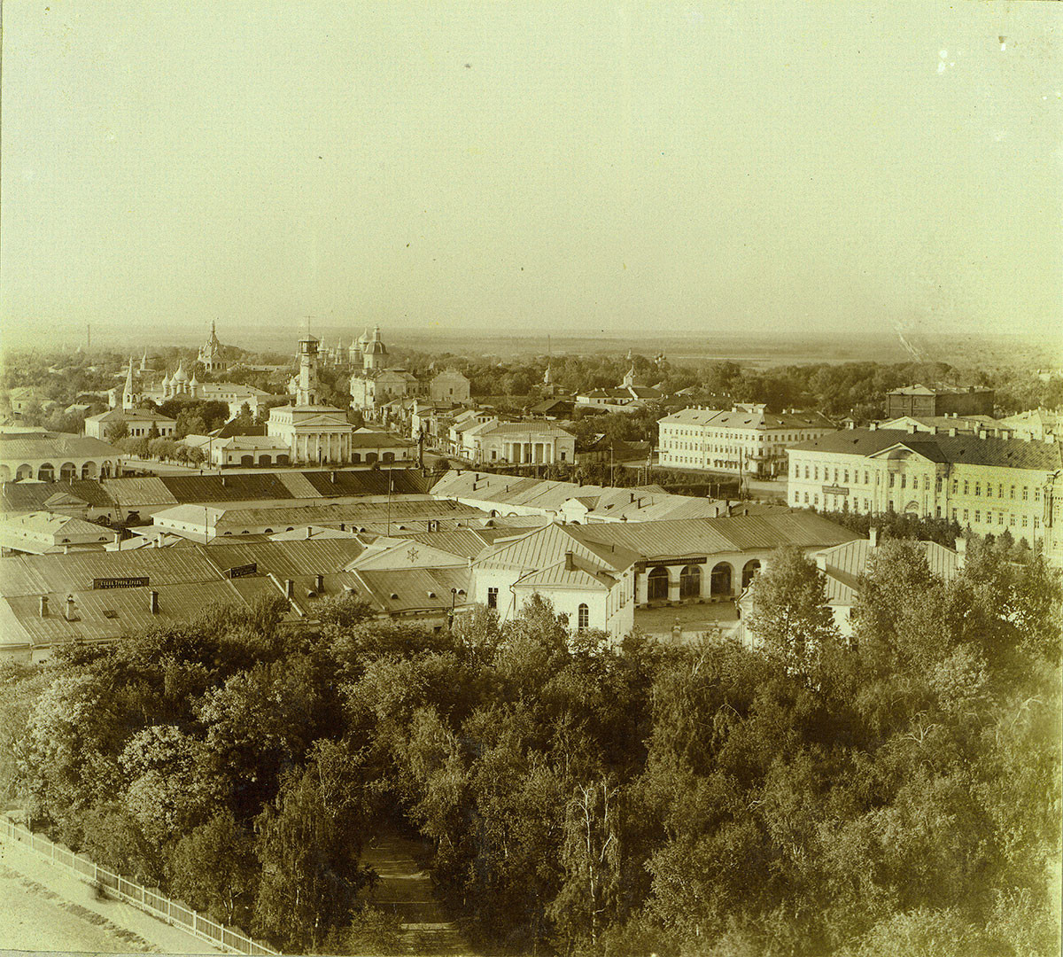 Kostroma. View of Susanin Square from bell tower of Epiphany Cathedral (demolished in 1934). Upper right: Epiphany Street leading to Epiphany Convent. Center: Fire tower on Susanin Square. Foreground. Large Flour Trading Rows. Summer 1910