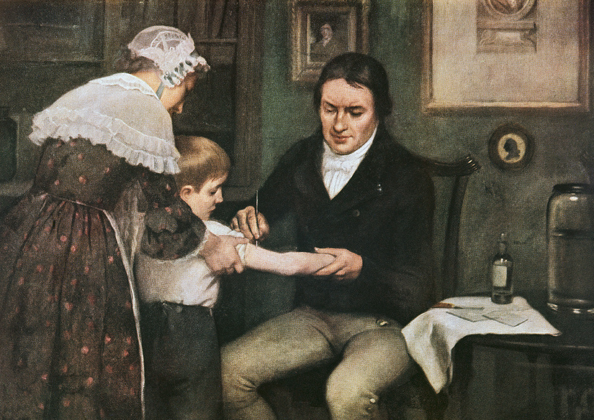 Dr Edward Jenner (1749-1823) performing his first vaccination against smallpox on James Phipps, a boy of eight, May 14, 1796, oil on canvas by Ernest Board (1877-1934).