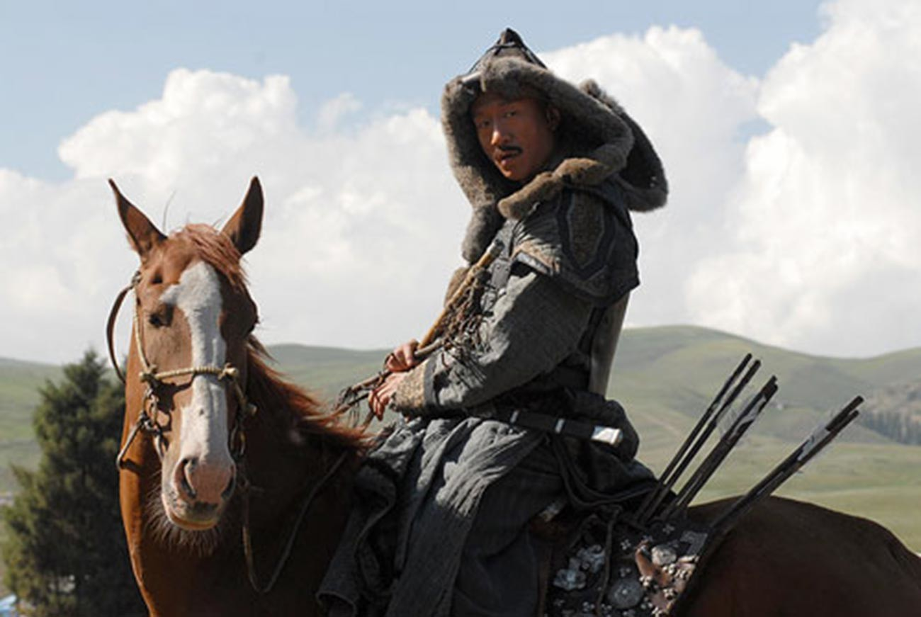 A still from 'Mongol' movie, 2007. A Mongol military commander is seen in a kind of shuba